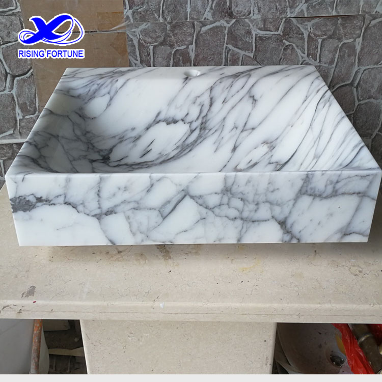 white marble wash basin