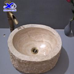 beige travertine basin